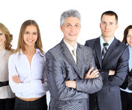 Business people team stand each other, smiling and posing for the camera. Isolated on white background Royalty Free Stock Image