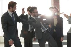 Business people team success celebration concept. Group of happy business people congratulating their successful coworker Royalty Free Stock Images