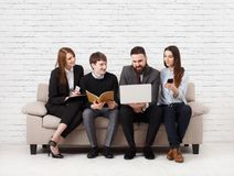 Business people teambuilding. Team on couch, partners working together stock image