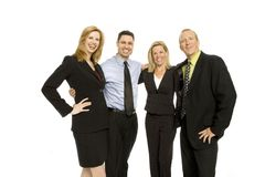 Business people teamwork. Four business people happily stand together Royalty Free Stock Images