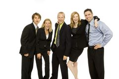 Business people teamwork. Five business people happily stand together Stock Image