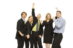 Business people teamwork. Five business people happily stand together, gesturing excitement Royalty Free Stock Photos