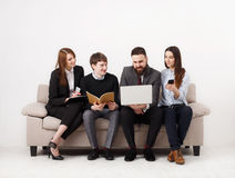Business people teamwork crop. Team on couch, partners working together Royalty Free Stock Photo
