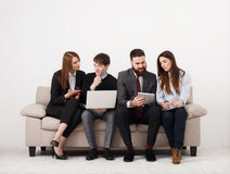 Business people teamwork crop. Team on couch, partners working together Stock Photography