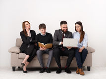 Business people teamwork crop. Team on couch, partners working together Stock Images