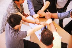 Business People Teamwork Meeting joining hands in office concept, Using Ideas, Charts, Computers, Tablet, Smart devices on busines. S planning table stock photos