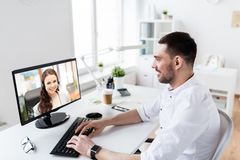 Businessman having video call on pc at office royalty free stock images