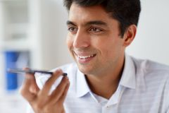 Close up of man using voice recorder on smartphone. Business, people and technology concept - close up of man using voice command recorder on smartphone at Royalty Free Stock Photography