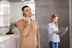 Businessman calling on smartphone at office Stock Image