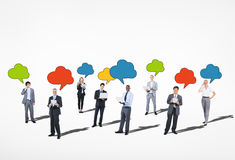 Business People with Technology and Speech Bubbles Stock Photo
