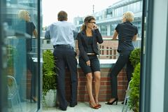 Business people on terrace Stock Photos