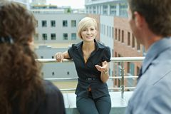 Business people on terrace Stock Photography
