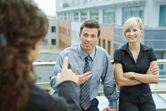 Business people on terrace Royalty Free Stock Images