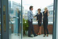 Business people on terrace Stock Photo