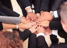 Business People With Their Hands Together. Group Of Business People With Their Hands Together Royalty Free Stock Photography