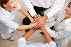 Business people with their hands together Stock Photo