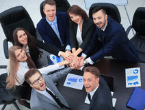 Business people with their hands together in a circle Royalty Free Stock Image