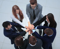 Business people with their hands together in a circle Stock Photos