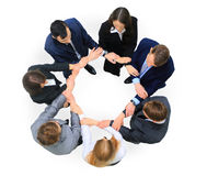 Business people with their hands together in a circle Stock Images