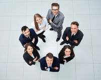 Business people with their hands together in a circle Royalty Free Stock Photography