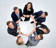 Business people with their hands together in a circle Stock Photo