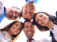 Business people with their heads together. Low angle view of business people with their heads together Stock Photos