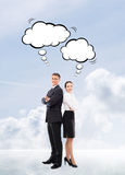 Business people with thinking clouds on sky background Stock Photos