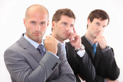 Business people in thought. Three  young business people in thought Royalty Free Stock Photo