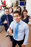 Business people with thumbs up Royalty Free Stock Images