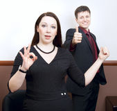 Business people with thumbs up at a conference Stock Image