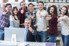 Business people with thumbs up Stock Photos