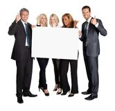Business people with thumbs up holding blank board. Isolated on white background Royalty Free Stock Images