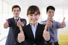 Business people with thumbs up Royalty Free Stock Photo