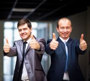 Business people with thumbs up. Successful business people with thumbs up and smiling Royalty Free Stock Photography