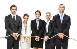 Business people tied with rope and their mouths are taped. Group of business people tied with rope and their mouths are taped , isolated on white. Concept of Stock Photos