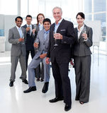 Business people toasting with Champagne. Multi-ethnic business people toasting with Champagne after a success Royalty Free Stock Photography