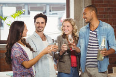 Business people toasting with champagne in office Royalty Free Stock Image