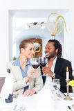 Business people toasting on deal with wine Stock Photos