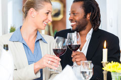 Business people toasting on deal with wine Stock Photo