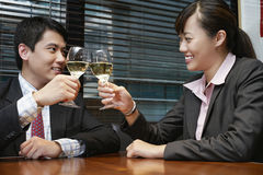 Business People Toasting Wineglasses At Cafe Table Stock Photography