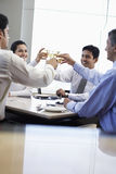 Business People Toasting Wineglasses In Restaurant Royalty Free Stock Photo