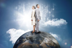 Business people on top of the world with computer matirx graphic Stock Images