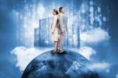 Business people on top of the world with data server Royalty Free Stock Photos