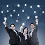 Business people touching a button Royalty Free Stock Photos