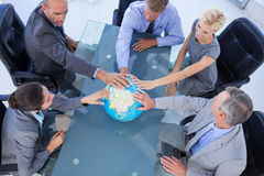 Business people touching a globe Royalty Free Stock Photo