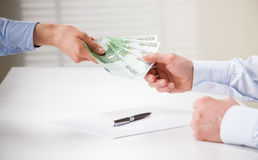 Business people transfering euro banknotes Stock Photography