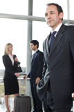 Business people traveling, waiting in airport or station Royalty Free Stock Images