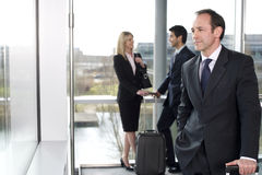 Business people traveling, waiting in airport or station Stock Image