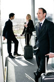Business people traveling, waiting in airport or station Stock Photo