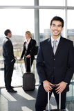 Business people traveling, waiting in airport or station Stock Photos